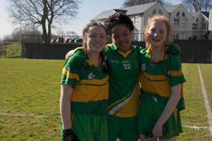 Loreto 3 girls in sportswear with arms around each other