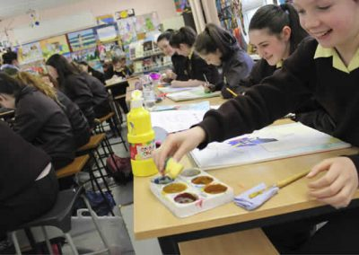 Loreto girls working at artwork